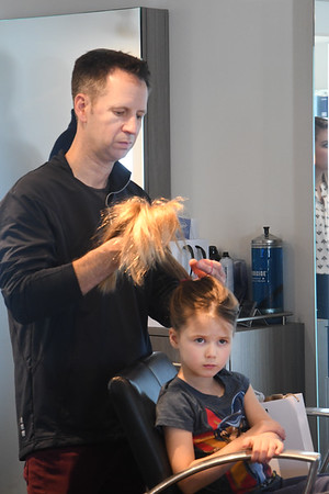 JIM VAIKNORAS/Staff photo Mark Baker, of Wenham, puts his daughter Mia, 6, hair in a pony tale at daddy daughter hair styling at Interlocks.