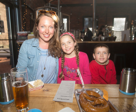 JIM VAIKNORAS/Staff photo Sannon Murray of Merrimac enjoys a beer with her JAJU pierogis at Silvaticus. Her kids Morgan and Ryder had a pretzel.