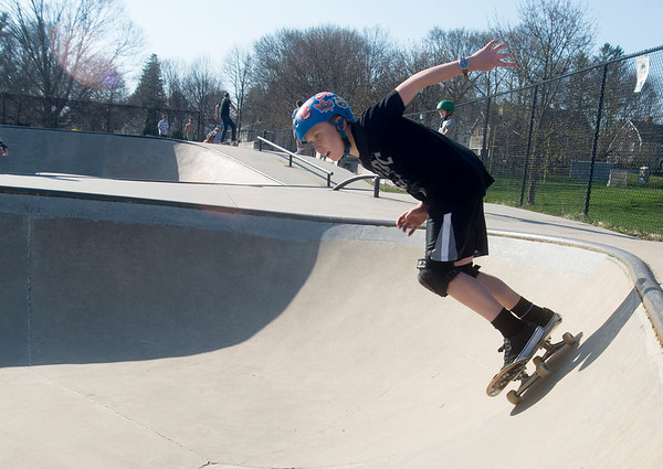 JIM VAIKNORAS/Staff photo Ben Shanley,12,of  Newbury carves the bowl at Newburyport Skate Park.