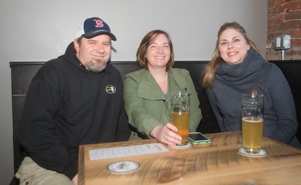 JIM VAIKNORAS/Staff photo Eric Stevenson, Amanda Burns and Amanda Langas enjoy a beer with their JAJU pierogis at Silvaticus.