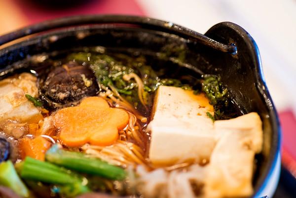 JIM VAIKNORAS/Staff photo Sukiyaki serves from a cast iron pot at the table at Hanna Japan in Newburyport.