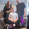 JIM VAIKNORAS/Staff photo Olivia LaGrasa, 2, of Beverly waits patiently as her dad Nick gets some brushing pointers from sylist Chelsi Berube at daddy daughter hair styling at Interlocks.