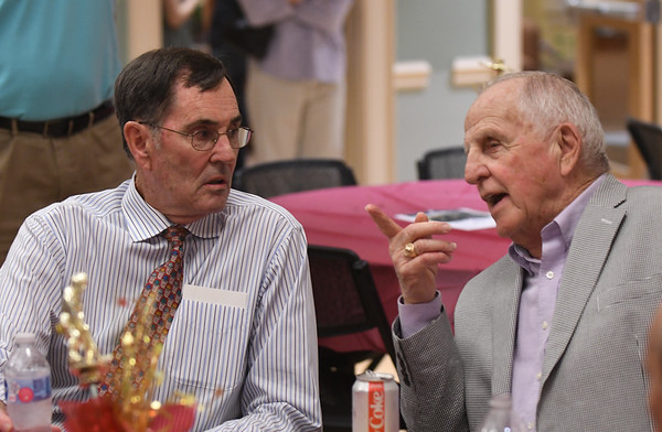 JIM VAIKNORAS/Staff photo Honoree Kevin Lucy, left , talks with his former coach and AD Jim Stehlin at the Show Your S'Port ceremony at the Newburyport  Senior Center.