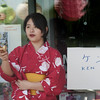 JIM VAIKNORAS/Staff photo    Miye Takahashi plays Ken Dama, a Japanese ball and stick game at the Natsu Matsuri or Summer festival at Hana Japan in Newburyport. Along with Japanese games , the event included music, dance, gifts and a variety of Japanese food.
