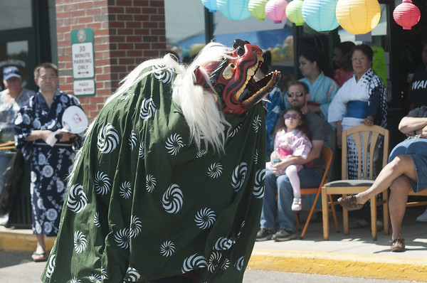 JIM VAIKNORAS/Staff photo    Stephen Long performs the Shishi-mai or Japanese Lion Dance at the Natsu Matsuri or Summer festival at Hana Japan in Newburyport. Along with Japanese dance , the event included music, games, gifts and a variety of Japanese food.