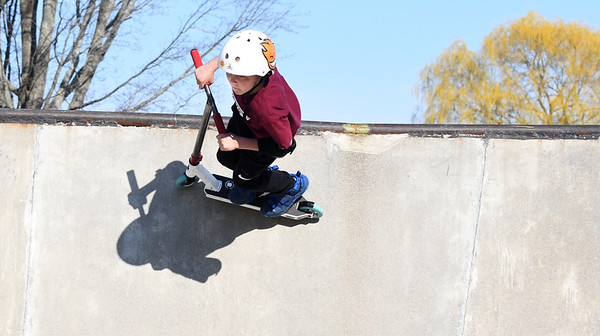 JIM VAIKNORAS/Staff photo  Tyler Jay,11 of Newbury, ride along teh top of one of the bowls on his razor scooter at the Newburyport Skate Park..