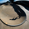 JIM VAIKNORAS/Staff photo Ambrose Lacey, 12, of Newbury, casts a long shadow as he skates in one of the bowls at Newburyport Skate Park.