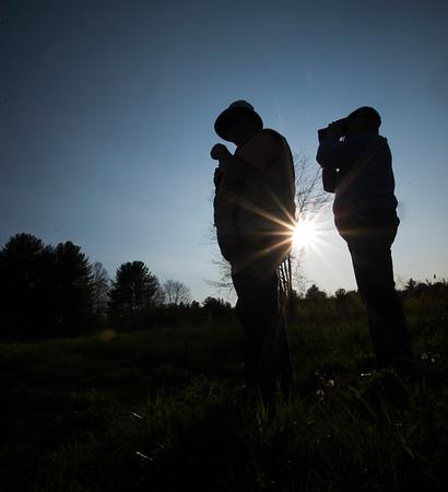 JIM VAIKNORAS/Staff photo Nancy Smith and Sue McGrath look for birds at Pikes Bridge Road in West Newbury.