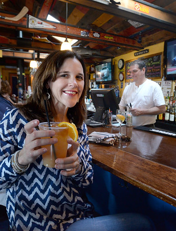 BRYAN EATON/Staff Photo. Jacquie Higgins of Newburyport likes to stop in to the Beachcoma on Sunday's when they have music in the late afternoon.