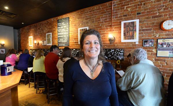 BRYAN EATON/Staff Photo. Nancy Pugh of Portland, Maine's gourmet sandwich shop Duckfat.
