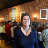 BRYAN EATON/Staff Photo. Nancy Pugh of Portland, Maine's gourmet sandwich shop Duckfat.