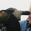 JIM VAIKNORAS/Staff photo Sue McGrath usesa spotting scope at the Parker River Wildlife refuge