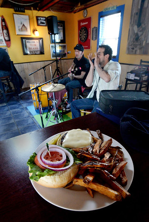 BRYAN EATON/Staff Photo. Charle Farr, left, and Jason Novak of Dark Horse Ramblers on a recent Sunday afternoon with Charlie's lunch waiting for him when they take a break.