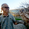 JIM VAIKORAS/Staff photo Dave Taylor at Triton high school with a one winged Barred Owl he rescued .