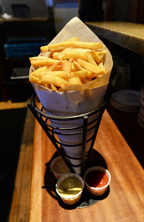 BRYAN EATON/Staff Photo. The signature hand-cut french fries cooked in duck fat.