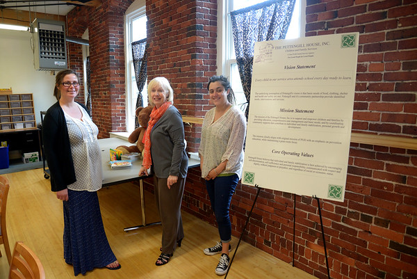 JIM VAIKNORAS/Staff photo Tara Clifford, Deb Smith, and Jackie Deorocki at the Pettengill House offices in Amesbury, ln December they recieved a $6000 donation from the Charity Girls.