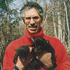 Dave Taylor with 2 bear cubs he rescued