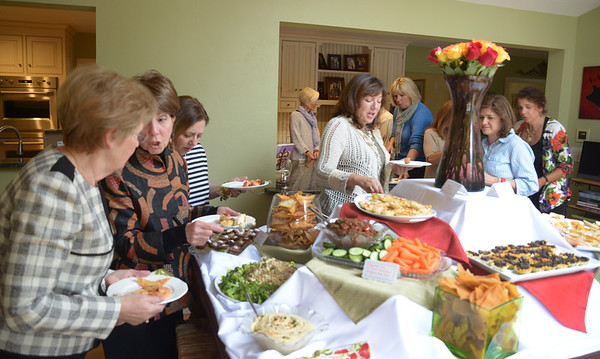 JIM VAIKNORAS/Staff photo Chartity Girls dig in at their monthly get together.