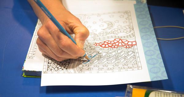 JIM VAIKNORAS/Staff photo Becca Lemos at adult coloring at the Newburyport Library.