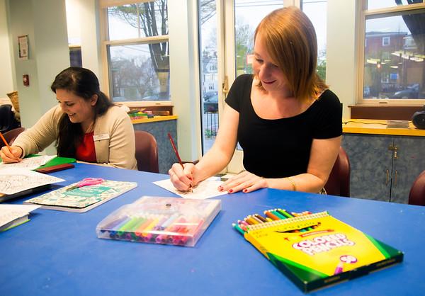JIM VAIKNORAS/Staff photo Becca Lemos and Sara Smith at adult coloring at the Newburyport Library.
