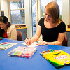 JIM VAIKNORAS/Staff photo Becca Lemos and Sara Smith at adult coloring at the Newburyport Library.