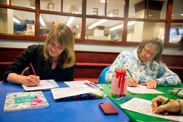JIM VAIKNORAS/Staff photo Beth Sceery and Eldeen Suda of Newburyport at adult coloring at the Newburyport Library.