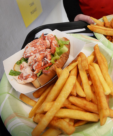 BRYAN EATON/Staff Photo. Bob Lobster's lobster roll with french fries.