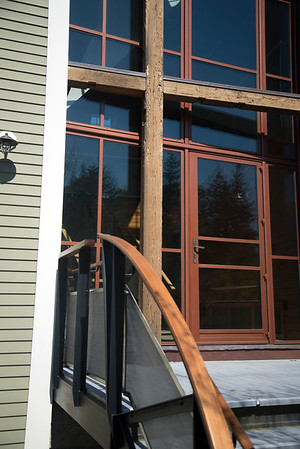 JIM VAIKNORAS/Staff photo Enrtance to the High Street carriage house. The cross beams are from the original barn.