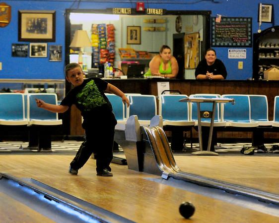 JIM VAIKNORAS/Staff photo Dominic Ricci bowls at Riverwalk Lanes in Amesbury.
