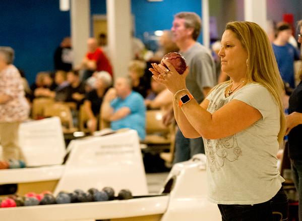 JIM VAIKNORAS/Staff photo Debbie Sewards bowls with her team at Leo's.