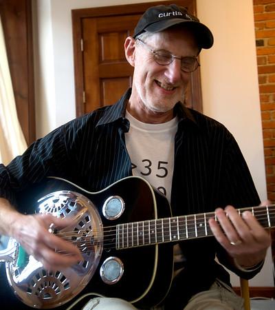 JIM VAIKNORAS/Staff photo Musician John Curtis plays steel guitar  at his Newburyport Studio.