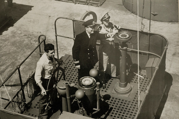 JIM VAIKNORAS/staff photo George Duffy on the right aboard the M.S. American Leader in a photo take in April of 1942, the ship was sunk by a German cruiser in September of the same year.