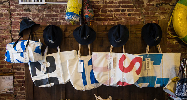 JIM VAIKNORAS/Staff photo Largel Totes starting at  $180 and Sea Bucket Hats $25 at Seabags