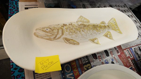 BRYAN EATON/Staff photo. A serving tray with image of a salmon.