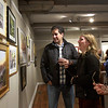 Brian Benson, Jessamyn Anderson, and Sheila Brigand view paintings at the Fall Members Juried Show Saturday, October 15, at Newburyport Art Association. Photo by Nicole Goodhue Boyd
