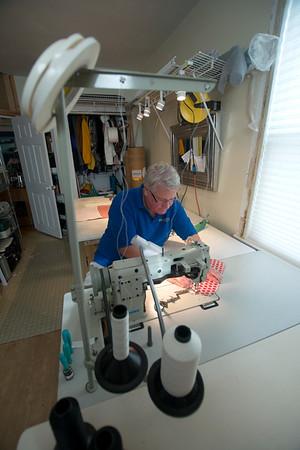 JIM VAIKNORAS/Staff photo Tom Secino  works on a bag at his Newburyport home.