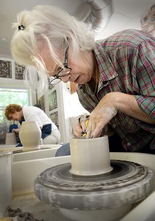 BRYAN EATON/Staff photo. Leslie Scanlon of Newbury shapes a bowl on the pottery wheel.