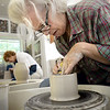 BRYAN EATON/Staff photo. Leslie Scanlon of Newbury shapes a bowl on the pottery wheel.
