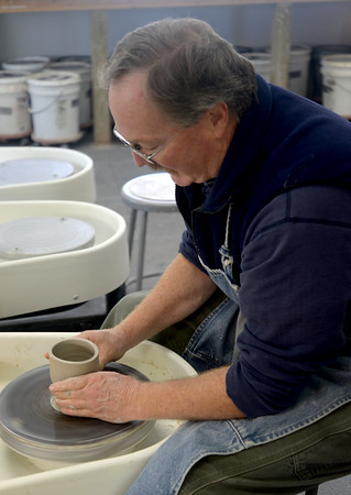 JIM VAIKNORAS/Staff photo Lloyd Hamovit of 2 River Ceramics throws some clay