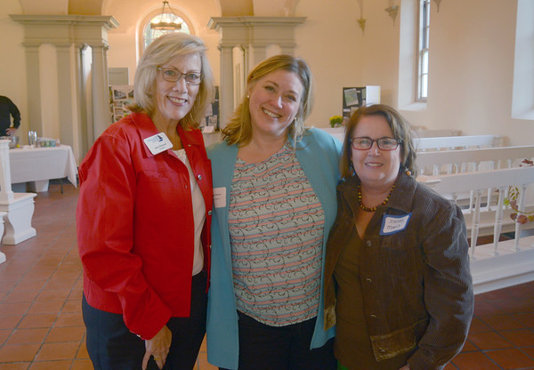 JIM VAIKNORAS/Staff photo Ann Ormond, of the Newburyport Chamber of Commerce, Vickie Piercey of the Essex Street Inn and Joanne Morris of Joanne Morris Events at the Camber Mixer at Oak Hill Cemetary.