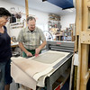 BRYAN EATON/Staff photo. Hamovit works with Rebbeca Simpson of Newbury on a press to flatten clay.