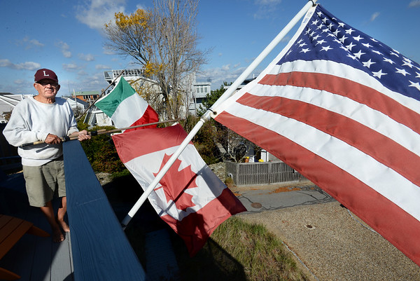 RYAN EATON/Staff photo. Plum Island resident George Bossi with the Italian, Canandian and US flags.