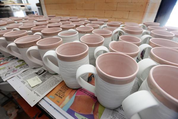 BRYAN EATON/Staff photo. Coffee or soup mugs made by Hamovit.