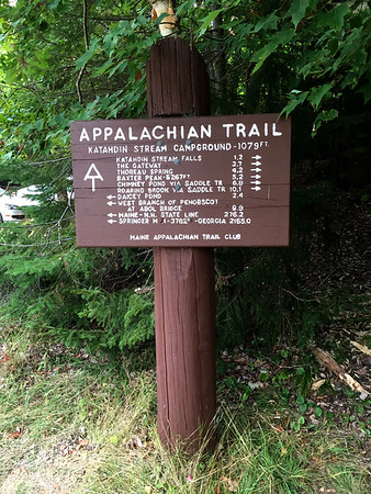 Sign near Mt Katahdin in Maine with distances to other parts of teh Appalachian Train including 2155 mile to Springer Mt in Georgia, teh Trails start.