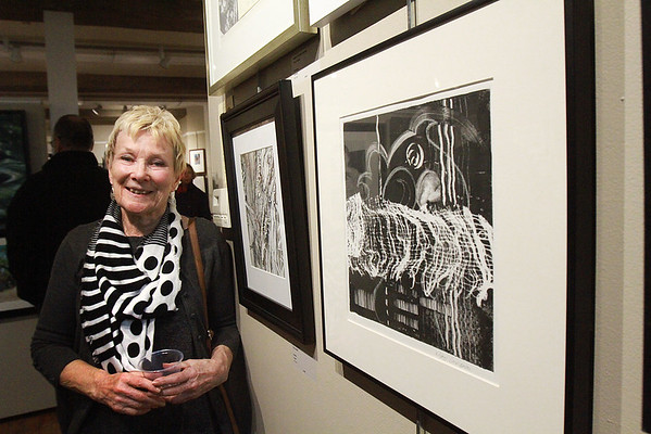 Sheila Bridgland poses with her painting that won an Honorable Mention for her Pen and Ink drawing, next to her head, at the Fall Members Juried Show Saturday, October 15, at Newburyport Art Association. Photo by Nicole Goodhue Boyd