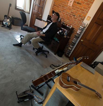 JIM VAIKNORAS/Staff photo Musician John Curtis with some of his instuments at his Newburyport Studio.