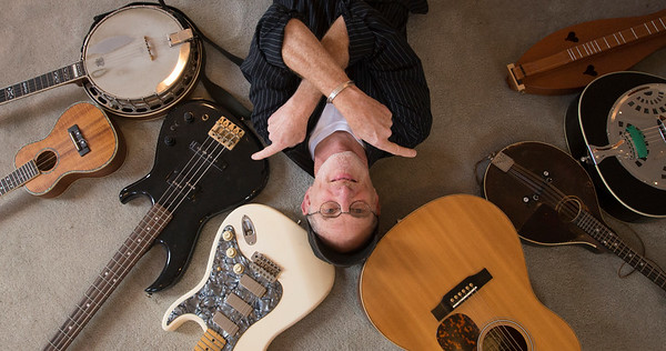 JIM VAIKNORAS/Staff photo Musician John Curtis with some of his instuments at his Newburyport Studio.