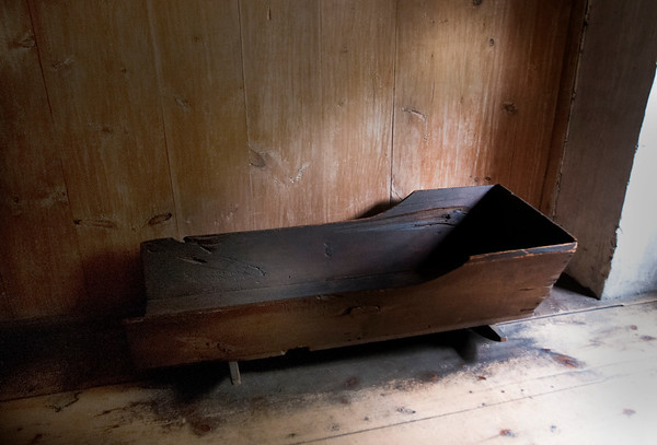 JIM VAIKNORAS/Staff photo An adult cradle in one of the upsairs bedrooms at the Coffin House.