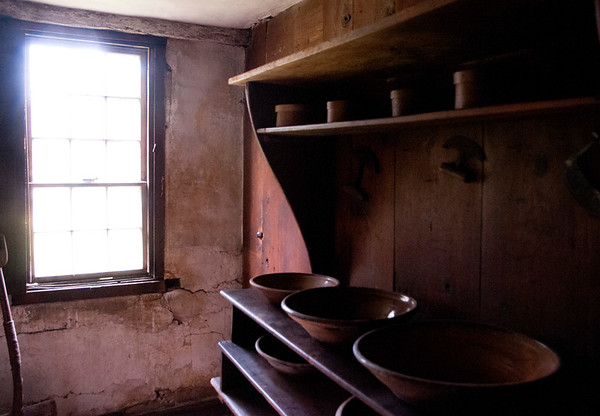 JIM VAIKNORAS/Staff photo Light falls on red clay pots in the buttery at the Coffin House.