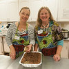 JIM VAIKNORAS/Staff photo Volunteers Susan Gabriel and Janet McEntee prepare food for the Annual African Dinner & Cultural Night Fundraiser at Nicholson Hall in Newburyport.